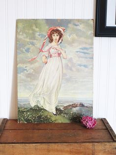 Beautiful copy of Pinkie as painted by Thomas Lawrence in 1794. Could be a wall hanging picture or just prop on a shelf or table. She is