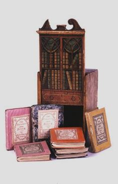 The miniature library depicted below, Infants Own Book-case (1800-1801), is typical of those produced by Darton, Harvey and other publishers: