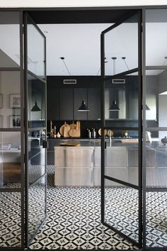 I like the sleek look of the kitchen along with the unique floor. I really like the large glass doors