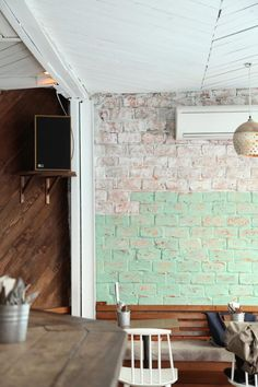 Touch of mint on exposed brick walls