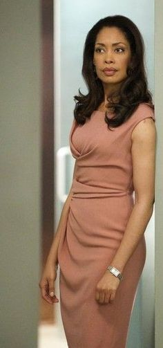 Gina Torres SUITS even a form fitting dress still let's everyone know who's in charge