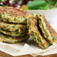 Zucchini Fritters  ~  A tiny little bit of cheese, a few tablespoons of flour, a few eggs, and a full truckload of grated zucchini. Now that's my kind of veggies!