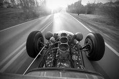 What a fabulous view; the open road looking down a Ford Flathead 8 with triple Holley 94s.