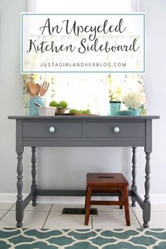 This was an old vanity at one time, but I love it as a kitchen sideboard! So much character, and the paint color is beautiful! | JustAGirlAndHerBlog.com