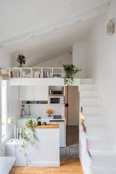 A white studio kitchenette Studio Kitchenette, House Design, Tiny House Loft, House Interior, Loft Interiors, Escalier Design, Home, Apartment Design, Tiny Spaces