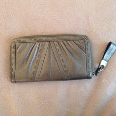 Cute wallet Silver outside and brown cheetah print inside. Only used a few times Bags Wallets