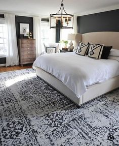 We finally found a large rug that worked in our master bedroom and are loving it! It's from and I love the… bedroom decor 40 Dreamy Master Bedroom Ideas and Designs — RenoGuide - Australian Renovation Ideas and Inspiration Master Bedroom Design, Dream Bedroom, Home Bedroom, Bedroom Furniture, Bedroom Designs, Bedroom Rugs, Dark Master Bedroom, Girls Bedroom, Modern Bedroom