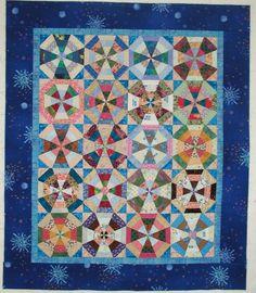Scrappy Blue Strip Pieced Kaleidoscope Quilt Top. $60.00, via Etsy.