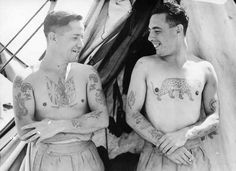 Gelatin silver photograph showing Private Burchall and L/Corp. Griffith displaying their tattoos. 1944.  Tattoos in Australia from between c.1857 & c.1948