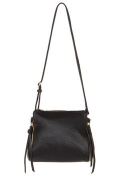 The Heat of the Moment Black Handbag is one purse you won't want to keep on the back burner! Stylish pebbled black vegan leather gives this purse a decidedly edgy look, with savvy accents brought forward by the functioning side zipper, with black vegan leather tassels, and a back zipper pocket. Snaps at the sides can expand the bag for extra storage space, and the top zipper opens to a roomy center pocket, with a zip pocket on one side, and two side pockets on the other for your cosmetics…