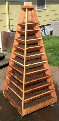 How To Build A Vertical Garden Pyramid Tower For Your Next DIY Outdoor Project - http://gardeningforyou.info/how-to-build-a-vertical-garden-pyramid-tower-for-your-next-diy-outdoor-project/