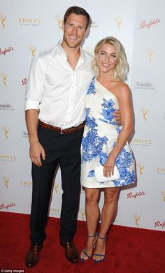 Happy couple: Julianne and Brooks looked completely loved up, snuggling up to each other o...