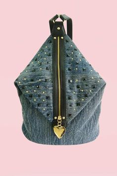 Funky, the denim rucksack by Anna Smith, a great zip at front finished with a heart logo, decorative from black and gold studs . The bag is fully lined with Anna Smith branded lining. This cool backpack has two adjustable shoulder straps.     Height 18 inches    Width: 16 inches