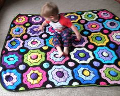 Charissa's REALTA Afghan. Pattern by Olivia Raisnford - Miss Rain on Ravelry. Model - Landen
