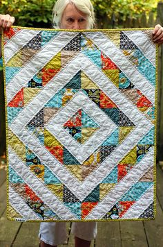 This gives me an idea for a different kind of quilt as you go method...I'll need to try it one day see if it will work.  (I wish this lady wasn't creeping over the top of this quilt! lol)