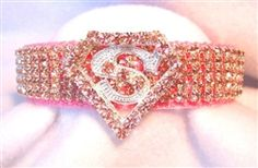 Starting at $44.95 - The Super Girlie Girl #Crystal Dog Collar was inspired by the #manofsteel, #Superman but with a powerful, #PINK twist!   It features pink crystals on a pink collar. This collar is pure PAWfection for your #superhero pets!  Sizes XS-2XL at Sugar Chic Couture:  https://www.sugarchiccouture.com/ProductDetails.asp?ProductCode=SGGDC-105  #SuperWoman #SuperGirl #pets #dogs #cute #shop #gifts #buy