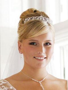 Bridal Hairstyle - High Bun with bangs and a veil with tiara