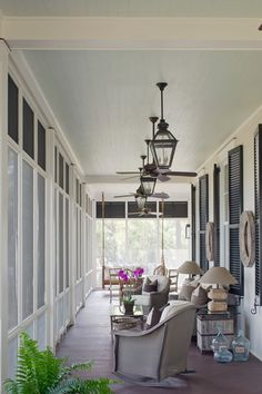 deep porches with lofty ceilings provide cooling shade to the home. With their screened enclosures, these porches really serve as outdoor rooms