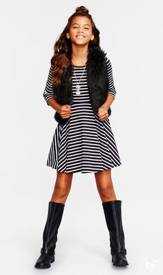 Stripe a pose in our black and white fit & flare dress. Hint: add tall boots and a faux-fur vest for a now-trending look with edge.