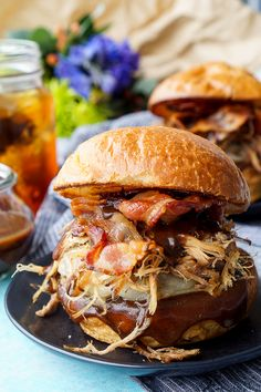 This Meat Lovers Cheeseburger is loaded up with a burger, pulled pork, and bacon! Topped with cheese and a sweet and tangy sauce, it's the ultimate burger!!
