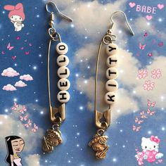 hello kitty safety pin earrings charms are so cute on the bottom handmade with love ships next day Weird Jewelry, Cute Jewelry, Jewelry Crafts, Safety Pin Jewelry, Safety Pin Earrings, Earrings Handmade, Handmade Jewelry, Grunge Jewelry, Cute Earrings