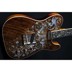 """Fender® Birdflower Telecaster® from the Fender CS. Pricing of 45.000 Euro! Master builder Yuriy Shishkov. Presented on the Namm in 2011. No CNC or laser used! Decorated with mother-of-pearl, different colors of abalone, silver wire and copper wire. Premium Ash Body, 'Claro walnut' blanket with Ivoroid Binding, AAA birdseye maple neck with modern C shape, Ebony fingerboard with 9.5"""" radius, 22 medium jumbo frets, Fender Texas Special pickup hand wound by Abigail Ybarra"""