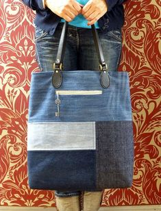 Denim applique bag I like the key zipper pull idea.Denim applique bag…,by ,Just Jude DesignsSo this is denim bag I took inspiration for this bag from here, and it was actually the first one I made of the set of Special features include twin needlin Denim Handbags, Denim Tote Bags, Denim Purse, Jeans Denim, Patchwork Bags, Quilted Bag, Crazy Patchwork, Bag Quilt, Diy Bags No Sew