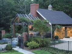Garage with outdoor patio and fireplace. Love idea of attaching gardens to other outside structures.....also nice rustic looking garage