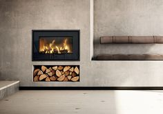 Find your new fireplace in a beautiful design that creates a warm centrepiece in your home. Get Scandinavian quality with a fireplace insert - RAIS Inset Fireplace, Fireplace Showroom, Wood Burner Fireplace, Fireplace Inserts, Modern Fireplace, Fireplace Wall, Living Room With Fireplace, Fireplace Design, Scandinavian Fireplace