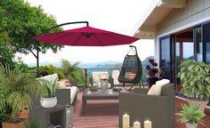 Une terrasse avec du mobilier en résine tressée