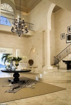 I would love a grand entrance/statement piece. gorgeous. too bad im not rich
