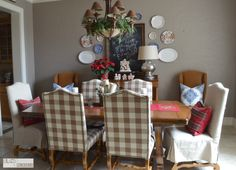Dining room - love the oversized Buffalo check, complementary chairs and pops of color