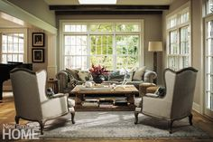 New windows with transoms let the sun wash the living room. Architecture: Ann Sellars Lathrop, Sellars Lathrop Architects Interior design: Sara Jordan, Photography: John Gould Bressler