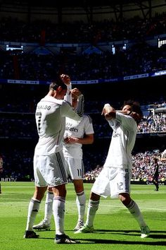 Cristiano Ronaldo celebrates a goal with Marcelo during the Spanish league football match Real Madrid CF vs Granada FC at the Santiago Bernabeu stadium in Madrid on April 5, 2015.