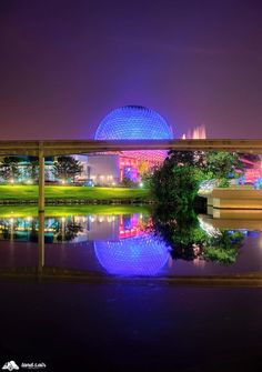 Spaceship Earth at Night with a great reflection off the calm waters at Epcot in Walt Disney World