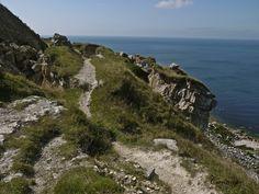 Falling cliffs at Portland Dorset, landslips on footpath.
