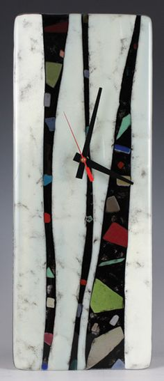 Created by Nina Cambron Undulating strips of French Vanilla come together with black waves of frit and rich shards of translucent glass in this fused glass clock. $199 16.5 h x 6.5 w x 1.5 d