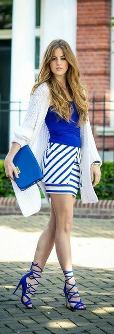 Love the stripes in different directions; love the blue; wish the skirt was a lot longer or even a tank instead.  Lara Rose