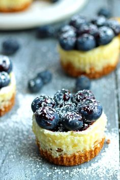 MINIATURE LEMON BLUEBERRY CHEESECAKES Soft lemony cheesecake meets blueberry jam for a recipe that's tangy and sweet. Get more mini cheesecake recipes at HouseBeautiful.com.