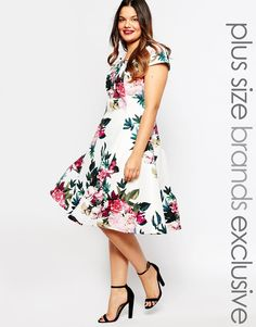 So the print would probably be too loud, especially since you haven't chosen your dress yet, but this a style I like. It has sleeves, is a nice length, springy, and semi formal.