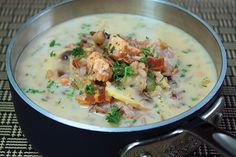 Salmon shines with wild rice, mushrooms and rosemary in this satisfying Mushroom, Salmon and Wild Rice Soup that's pure Pacific Northwest comfort food.