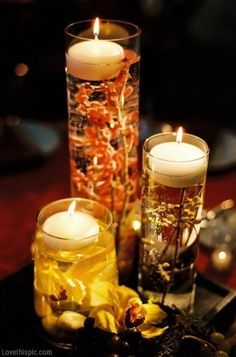 You could do these as center pieces with varying heights. I even have floating candles for you :)