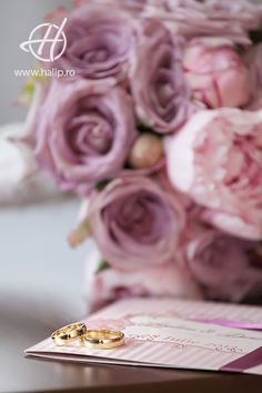 wedding rings and invitation with bouquet in background  # theHphoto