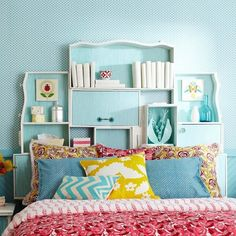 Don't love the colors, but just adore the odd shaped bookshelf above the bed. <3