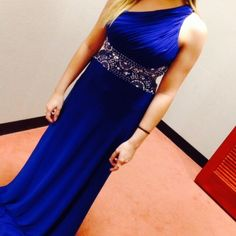 Blue Prom Dress worn once. great condition with a few beads missing but not very noticeable. Hemmed for someone who is 4'10 to 5'2. Dresses
