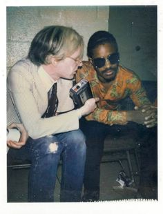 Andy Warhol with Stevie Wonder backstage Madison Square Garden, at a Rolling Stones show Stevie opened, July 26, 1972 (Mick's 29th birthday).