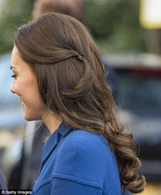 Kate, 35, also showcased a subtle style tweak by wearing her tendrils of her brunette hair...