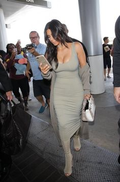 Kim Kardashian Form-Fitting Dress - Kim Kardashian played up her amazing curves in a taupe tank dress by Mark Wong Nark while catching a flight at LAX.
