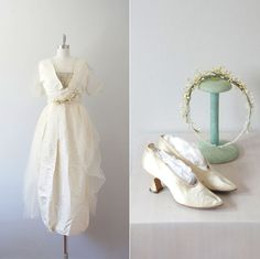 Late Edwardian/WWI Wedding Ensemble, circa 1914-15 via eBay | Measurements: 34-27-full Shoes: aprox. 37 (6.5 US) Materials: White silk and tulle Details: Full ensemble including gown, shoes, and headband decorated with wax orange blossoms