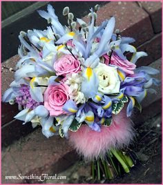 Fresh floral bridal bouquet featuring roses, iris and lilacs. Designed Something Floral/Something Spectacular, Warren, MI. Photo by Urban Fire Studio. #bouquet #wedding #spring #flowers #lavender #blue #pink